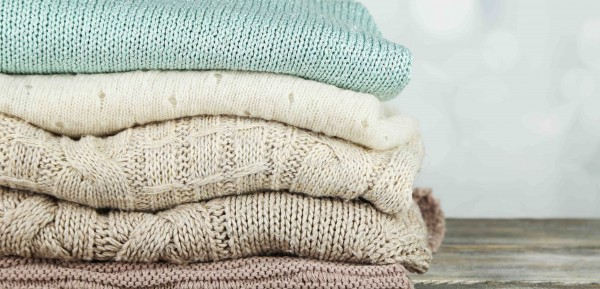 Pile-of-woollen-sweaters-e1421012034539-600x289